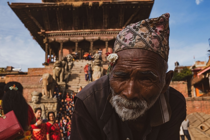 man peering at the camera, Bhaktapur, Nepal