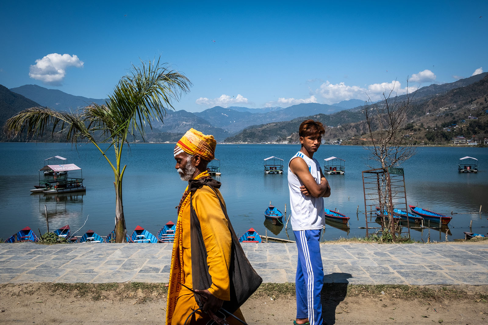 sadhu and young boy at lakeside Pokhara, Nepal