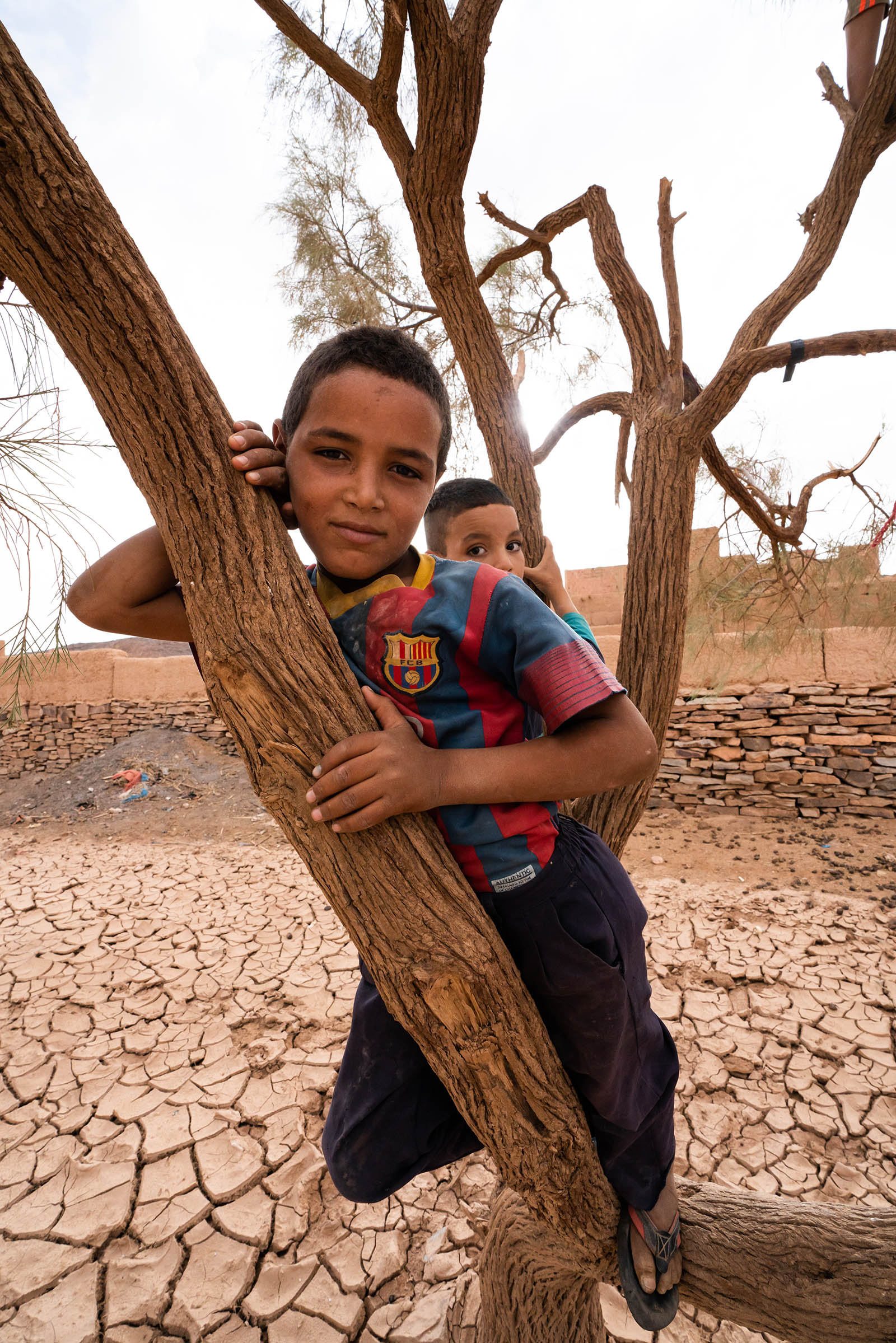 two boys pose for a picture in Tafraoute, Morocco