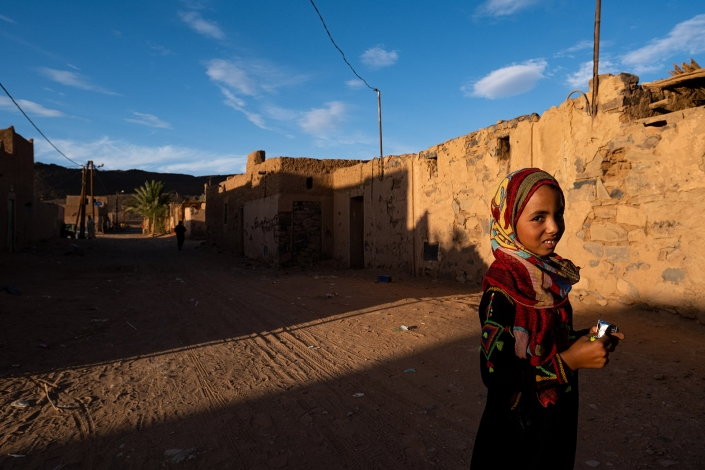 Young girl poses for photo in tafraoute, Morocco