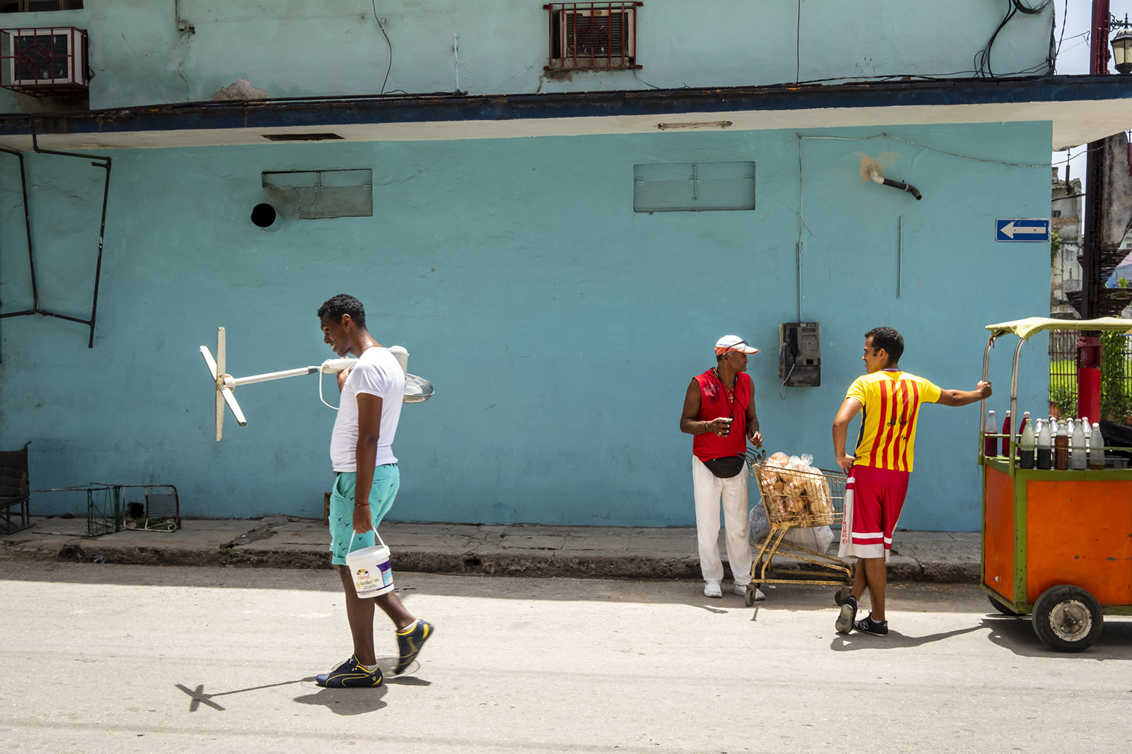 man walking with a fan, Havana Cuba