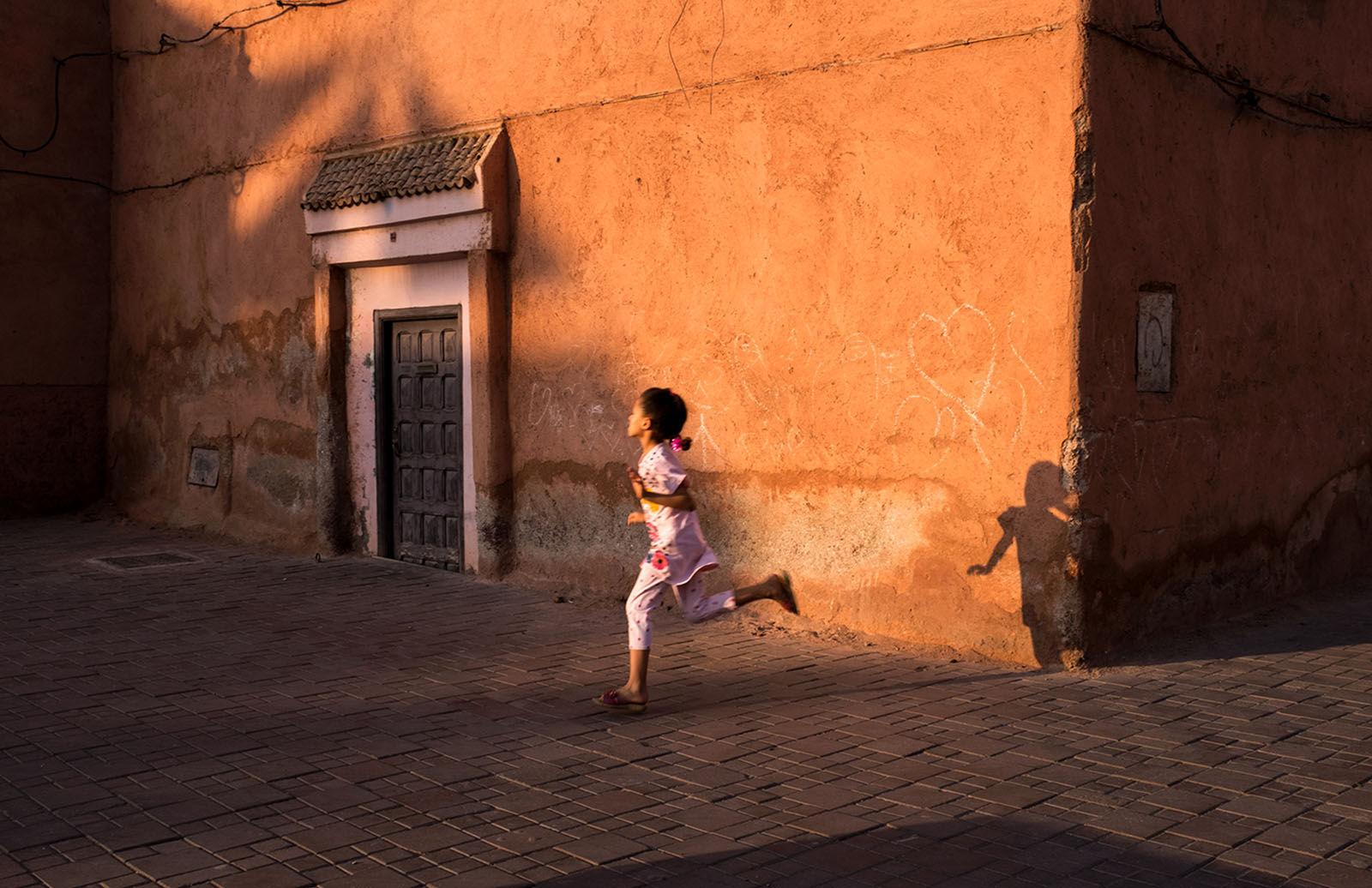 Girl running in Marakech, Morocco