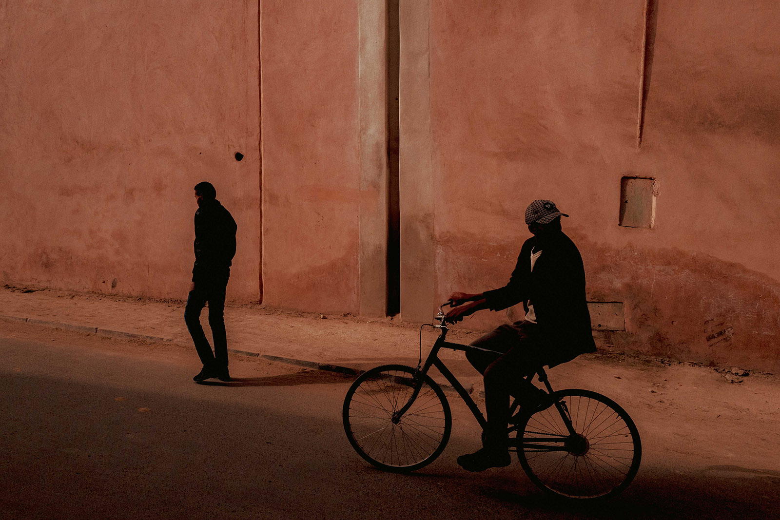 Man on bike looking back in Marrakech, Morocco
